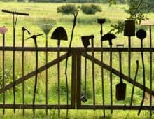 gardening equipment on a fence